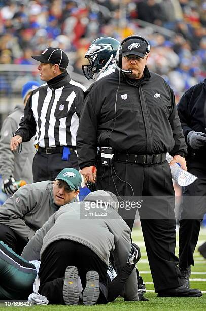 Andy Reid Head Coach of the Philadelphia Eagles looks concerned as Nate Allen receives medical attension during their game against the New York...