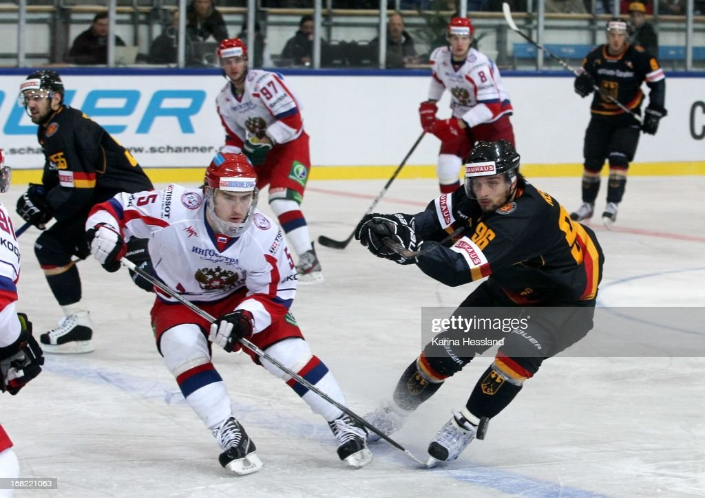 Andy Reiss of Germany challenges Vasily Streltsov of Russia during the Top Teams Sochi match between Germany and Russia at Kuechwaldhalle on December 11, 2012 in Chemnitz, Germany.