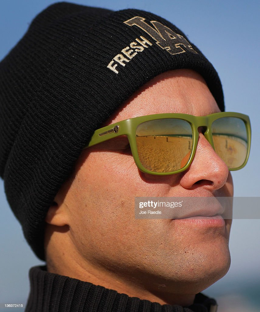 Andy Reiter wears a sweater and wool cap as he bundles up against the cool weather looking out at the ocean before surfing January 3, 2012 in Miami Beach, Florida. South Florida experienced one of the coolest days of the winter season and tomorrow is expected to be colder with temperatures expected to dip into the 30s inland and low 40s on the coast.