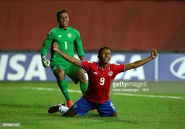 Andy Reyes of Costa Rica reacts after making his penatly kick to defeat France 53 on penalty kick shootout as goalkeeper Alejandro Barrientos of...