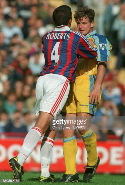 Andy Roberts of Crystal Palace squares up to Mark Hughes Chelsea