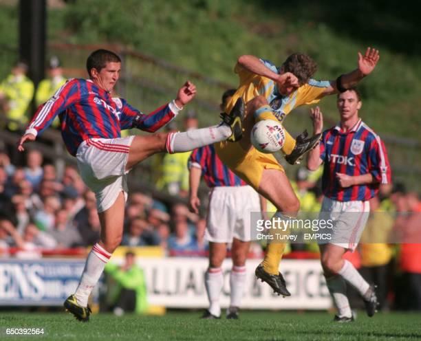 Andy Roberts of Crystal Palace tackles Mark Hughes Chelsea