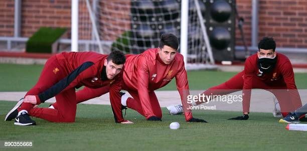 Andy Robertson Kamil Grabara and Dominic Solanke of Liverpool during a training session at Melwood Training Ground on December 11 2017 in Liverpool...