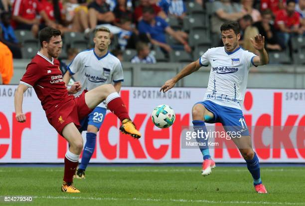 Andy Robertson of Liverpool battles for the ball with Mathew Leckie of Berlin during the pre season friendly match between Hertha BSC and FC...