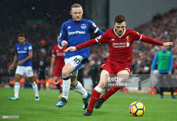 Andy Robertson of Liverpool holds off Wayne Rooney of Everton during the Premier League match between Liverpool and Everton at Anfield on December 10...