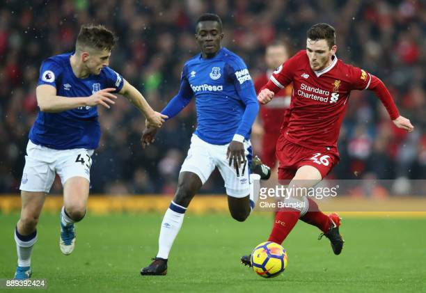 Andy Robertson of Liverpool is challenged by Idrissa Gueye of Everton and Jonjoe Kenny of Everton during the Premier League match between Liverpool...