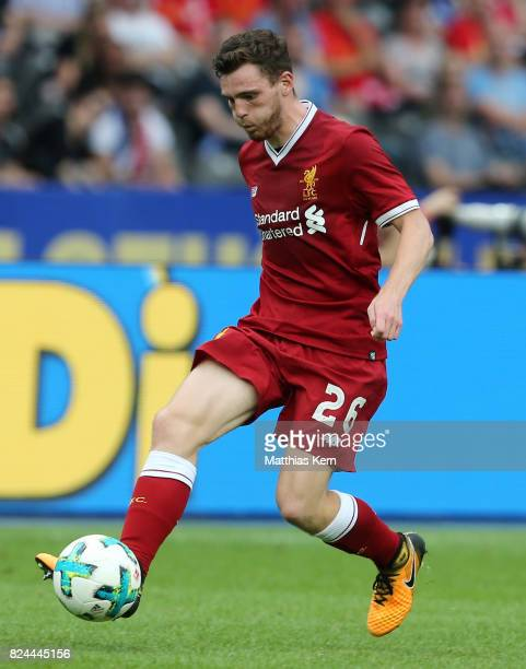 Andy Robertson of Liverpool runs with the ball during the pre season friendly match between Hertha BSC and FC Liverpool at Olympiastadion on July 29...