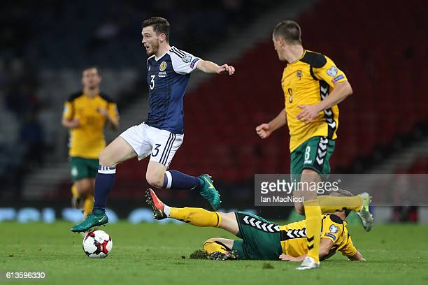 Andy Robertson of Scotland evades Arvydas Novikovas of Lithuania during the FIFA 2018 World Cup Qualifier between Scotland and Lithuania at Hampden...