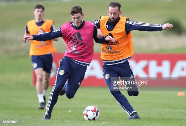 Andy Robertson vies with Steven Fletcher during a training session at Mar Hall on March 23 2017 in Erskine Scotland