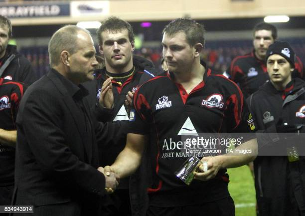 Andy Robinson shakes the hand of loser Edinburgh's Steven Lawrie