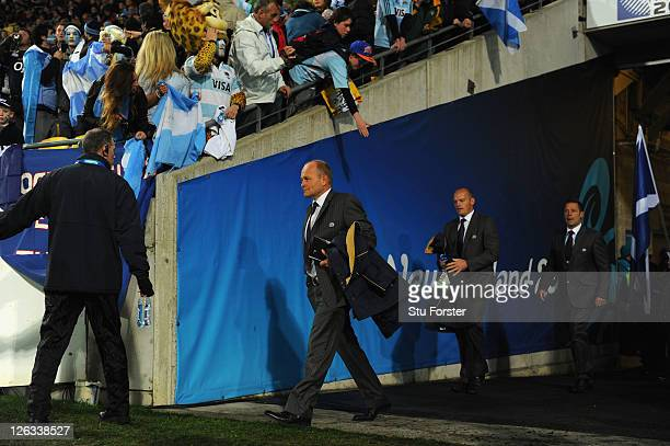 Andy Robinson the coach of Scotland and his attack coach Gregor Townsend walk out onto the pitch prior to kickoff during the IRB 2011 Rugby World Cup...