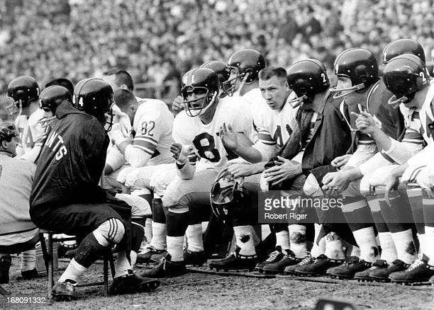 Andy Robustelli of the New York Giants talks to teammates on the sideline during a game circa 1960's