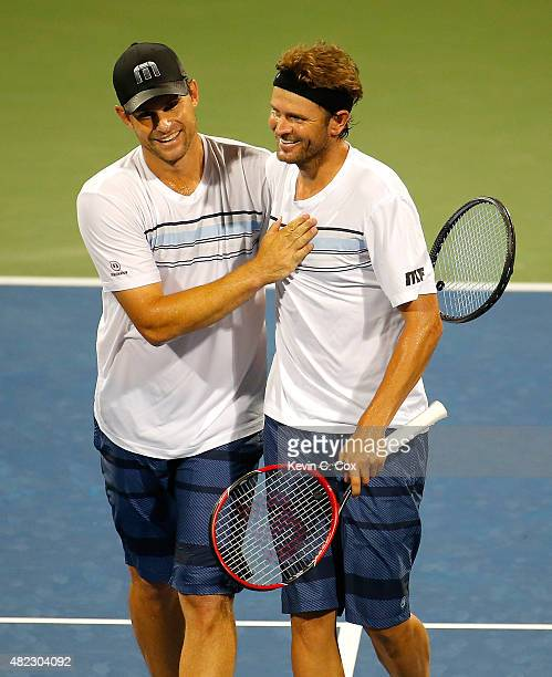 Andy Roddick and Mardy Fish celebrate their win over YenHsun Lu of Chinese Taipei and Jonathan Marray of Great Britain during the BBT Atlanta Open at...