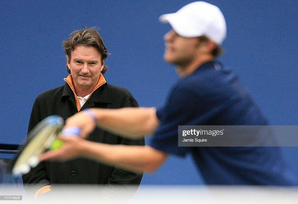 Andy Roddick is watched by his coach, tennis legend Jimmy Connors, as he practices on center court during a rain delay at the U.S. Open at the USTA Billie Jean King National Tennis Center in Flushing Meadows Corona Park on September 2, 2006 in the Flushing neighborhood of the Queens borough of New York City.