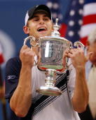 Andy Roddick of the United States holds the trophy after defeating Juan Carlos Ferrero of Spain 63 76 63 in the men's finals 07 September at the US...