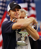 Andy Roddick of the United States hugs the trophy after defeating Juan Carlos Ferrero of Spain 63 76 63 in the men's finals 07 September at the US...