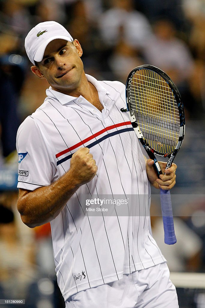 <a gi-track='captionPersonalityLinkClicked' href=/galleries/search?phrase=Andy+Roddick&family=editorial&specificpeople=167084 ng-click='$event.stopPropagation()'>Andy Roddick</a> of the United States reacts against Juan Martin Del Potro of Argentina during his men's singles fourth round match against on Day Nine of the 2012 U.S. Open at the USTA Billie Jean King National Tennis Center on September 4, 2012 in the Flushing neighborhood, of the Queens borough of New York City.