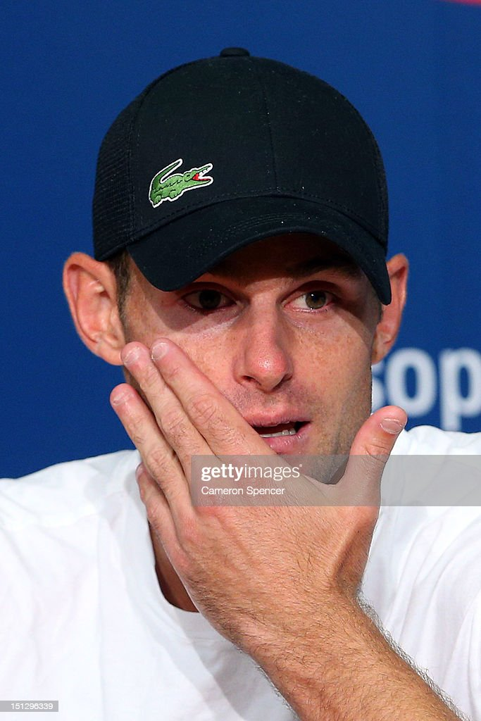 Andy Roddick of the United States reacts during a post match press conference following his men's singles fourth round match against Juan Martin Del Potro of Argentina on Day Ten of the 2012 US Open at USTA Billie Jean King National Tennis Center on September 5, 2012 in the Flushing neighborhood of the Queens borough of New York City.