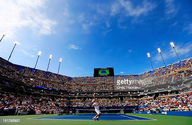 Andy Roddick of the United States serves against Juan Martin Del Potro of Argentina during their men's singles fourth round match on Day Ten of the...