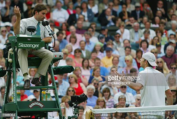 Andy Roddick of the US complains about a call to chair umpire Enric Molina during his semifinal round match against Roger Federer of Switzerland at...