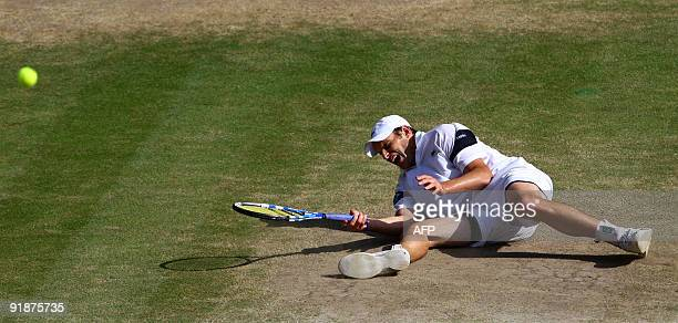 Andy Roddick of the US falls as he plays against Switzerland's Roger Federer in the Men's Singles Final of the 2009 Wimbledon Tennis Championships at...