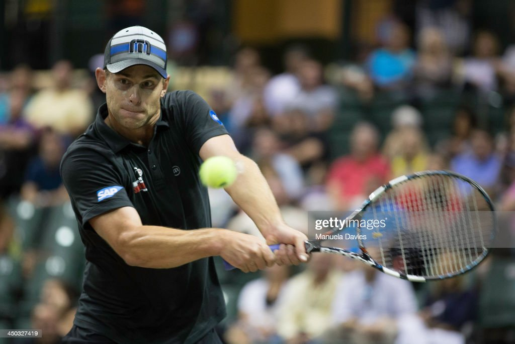 <a gi-track='captionPersonalityLinkClicked' href=/galleries/search?phrase=Andy+Roddick&family=editorial&specificpeople=167084 ng-click='$event.stopPropagation()'>Andy Roddick</a> of the U.S. hits a backhand during the exhibition singles match against John Isner during the 2013 Mylan WTT Smash Hits on November 17, 2013 at the ESPN Wide World of Sports Complex in Lake Buena Vista, Florida.