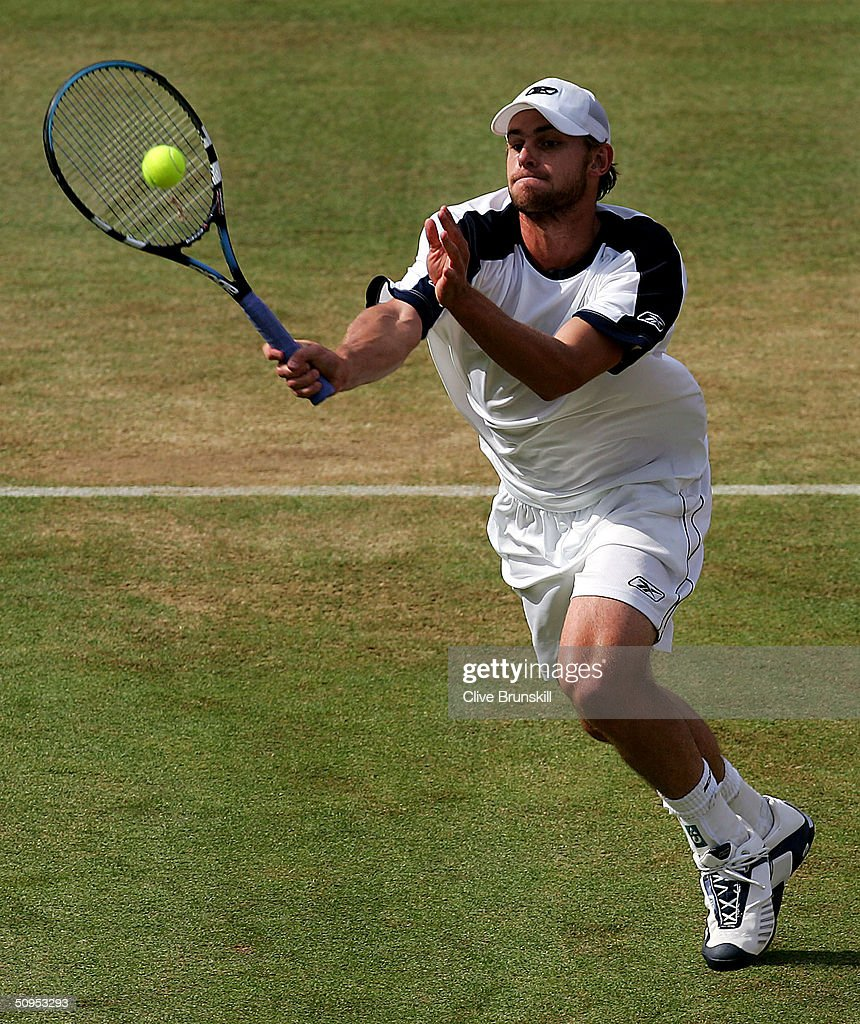 Andy Roddick of the U.S. is shown in action during his semi-final match against Lleyton Hewitt of Australia at the Stella Artois Tennis Championships at the Queen?s Club June 12, 2004 in London.