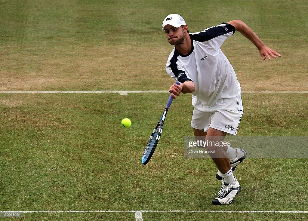 Andy Roddick of the U.S. is shown in action during his semi-final match against Lleyton Hewitt of Australia at the Stella Artois Tennis Championships at the Queen?s Club June 12, 2004 in London, England.