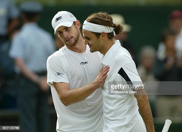 Andy Roddick of the USA congratulates Roger Federer of Switzerland after Federer won the men's singles final match at the Wimbledon Lawn Tennis...