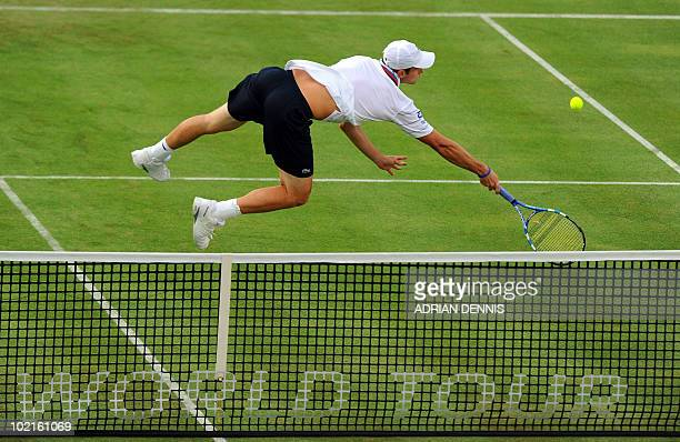 Andy Roddick of the USA dives in an attempt to hit a backhand shot against Igor Kunitsyn of Russia during their second round singles match on the...