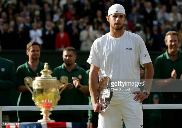 Andy Roddick of USA holds his runnersup trophy after he was defeated by Roger Federer of Switzerland at the Wimbledon Lawn Tennis Championship on...