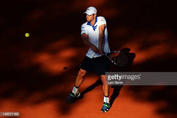 Andy Roddick of USA plays a backhand during his match against Go Soeda of Japan during day five of Power Horse World Team Cup at Rochusclub on May 24...