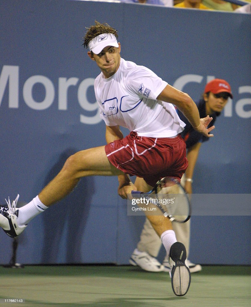 Andy Roddick pulls out all the stops, hitting shots from all over the court to win over Juan Ignacio Chela, 5-7, 6-4, 6-4, 6-4.