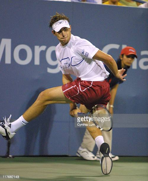 Andy Roddick pulls out all the stops hitting shots from all over the court to win over Juan Ignacio Chela 57 64 64 64