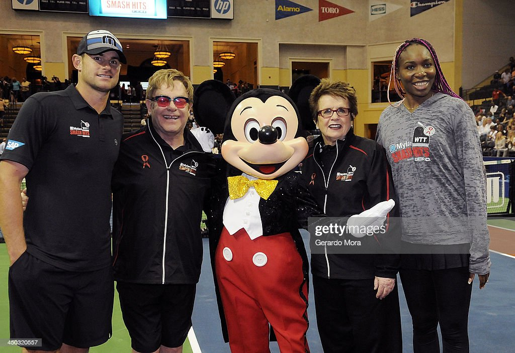Andy Roddick, Singer Sir Elton John, tennis legend Billie Jean King and Venus Williams pose with Disney character Mickey Mouse during the Mylan World TeamTennis Matches at ESPN Wide World of Sports Complex on November 17, 2013 in Lake Buena Vista, Florida.