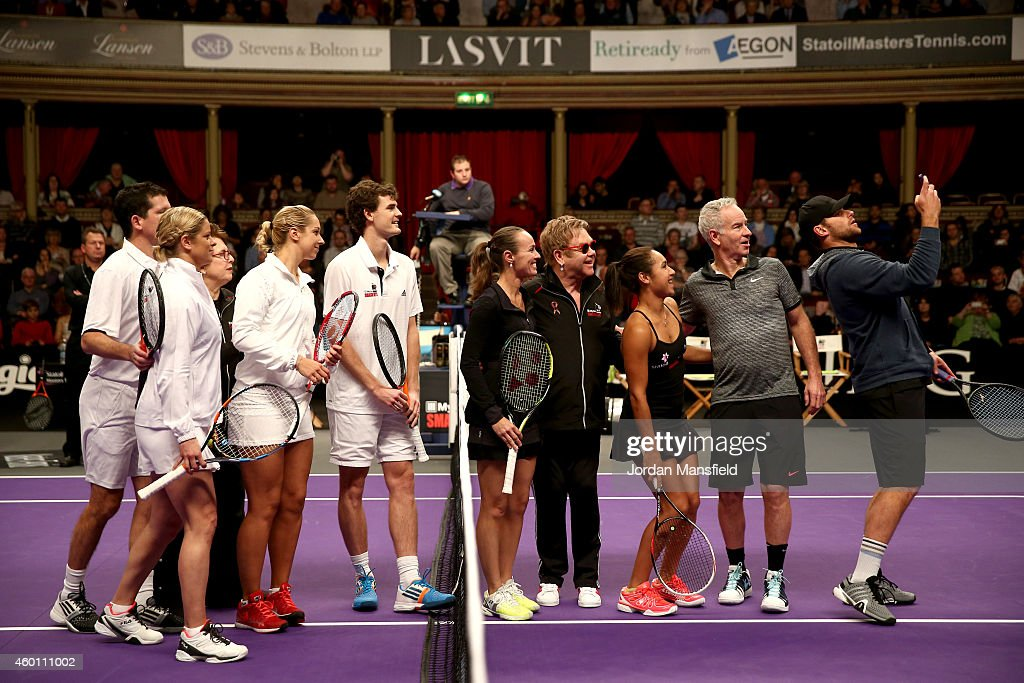 Andy Roddick takes a selfie of himself with Tim HenmanKim Clijsters Billie Jean King Sabine Lisicki Jamie Murray Martina Hingis Sir Elton John...