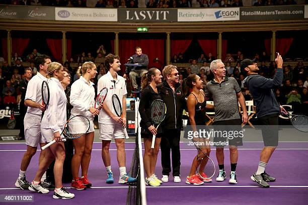 Andy Roddick takes a selfie of himself with Tim HenmanKim Clijsters Billie Jean King Sabine Lisicki Jamie Murray Martina Hingis Sir Elton John...
