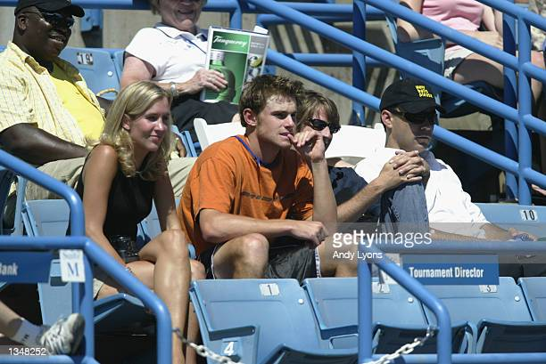 Andy Roddick watches the action with performer Dave Matthews during the Western Southern Financial Group Masters on August 7 2002 at the ATP Tennis...