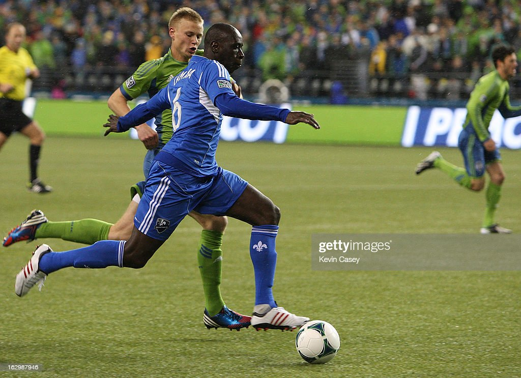 Andy Rose #25, of the Seattle Sounders, chases Hassoun Camara #6, of Montreal Impact, in the first half at CenturyLink Field on March 2, 2013 in Seattle, Washington.