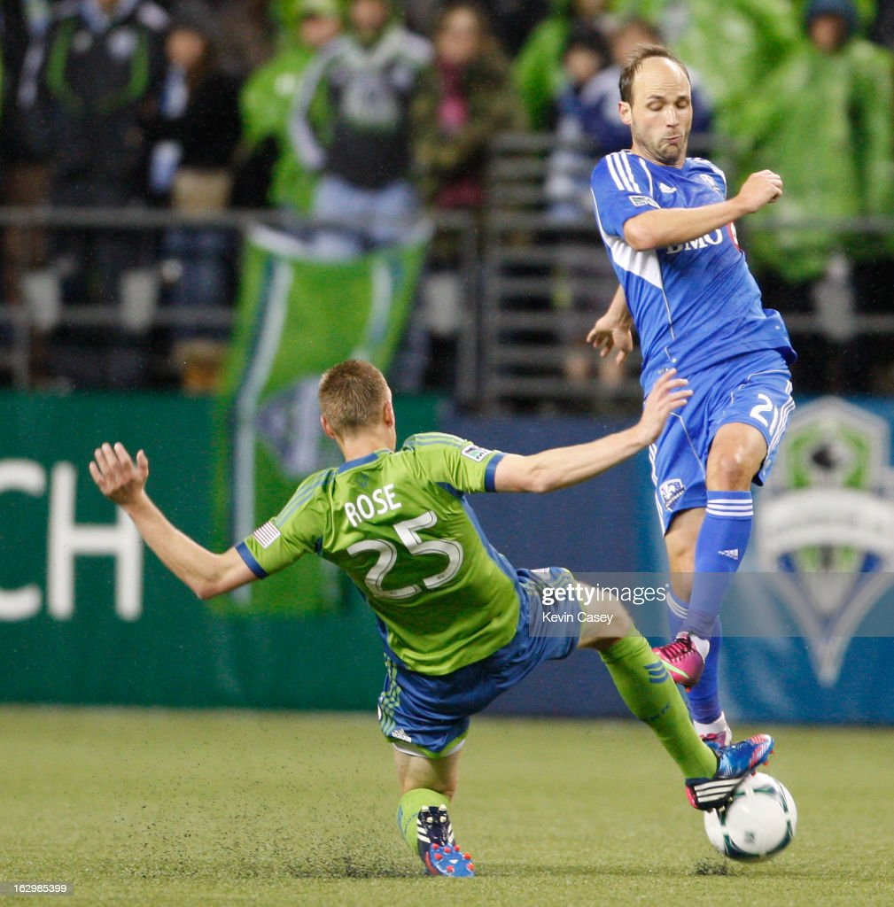 Andy Rose of the Seattle Sounders stops the ball as Justin Mapp of Montreal Impact tries to pass in the first half at CenturyLink Field on March 2...