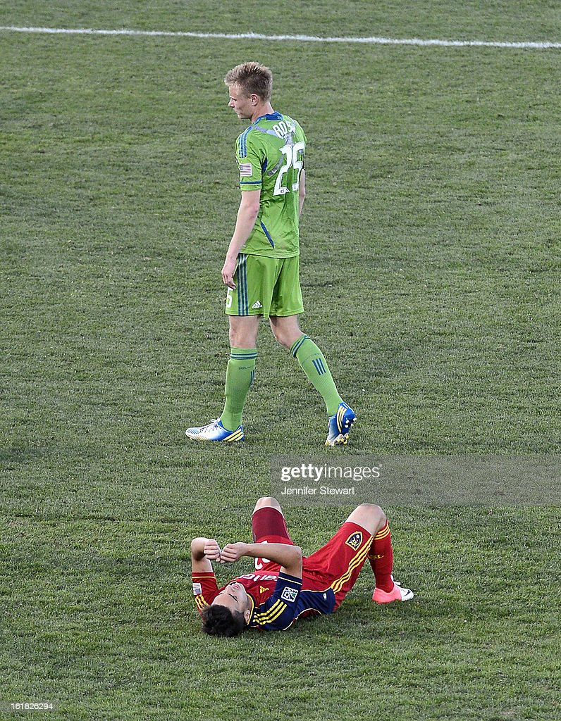 Andy Rose #25 of the Seattle Sounders walks by David Viana #22 of Real Salt Lake as he lies on the ground after loosing the game during the FC Tucson Desert Diamond Cup at Kino Sports Complex on February 16, 2013 in Tucson, Arizona. Seattle Sounders defeated Real Salt Lake 2-1.