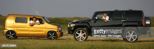 Andy Saunders from Poole Dorset proudly shows off the mini Hummer which he has constructed from a Suzuki Wagon R beside his friend Mick Harris' own...