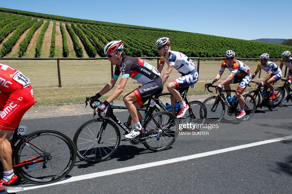 Andy Schleck (2nd L) from Luxemburg rides in front of vineyards during the 116.5km stage two of the Tour Down Under in Adelaide on January 23, 2013. The six-stage Tour Down Under takes place from January 20 to 27. AFP PHOTO / Mark Gunter USE