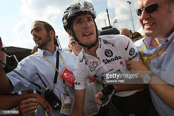 Andy Schleck of Luxembourg from team Saxo Bank is surrounded by the media and his team after winning stage eight of the Tour de France July 11 2010...