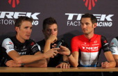 Andy Schleck of Luxembourg passes the microphone to his brother Frank Schleck of Luxembourg as Danny van Poppel of the Netherlands looks on as the...