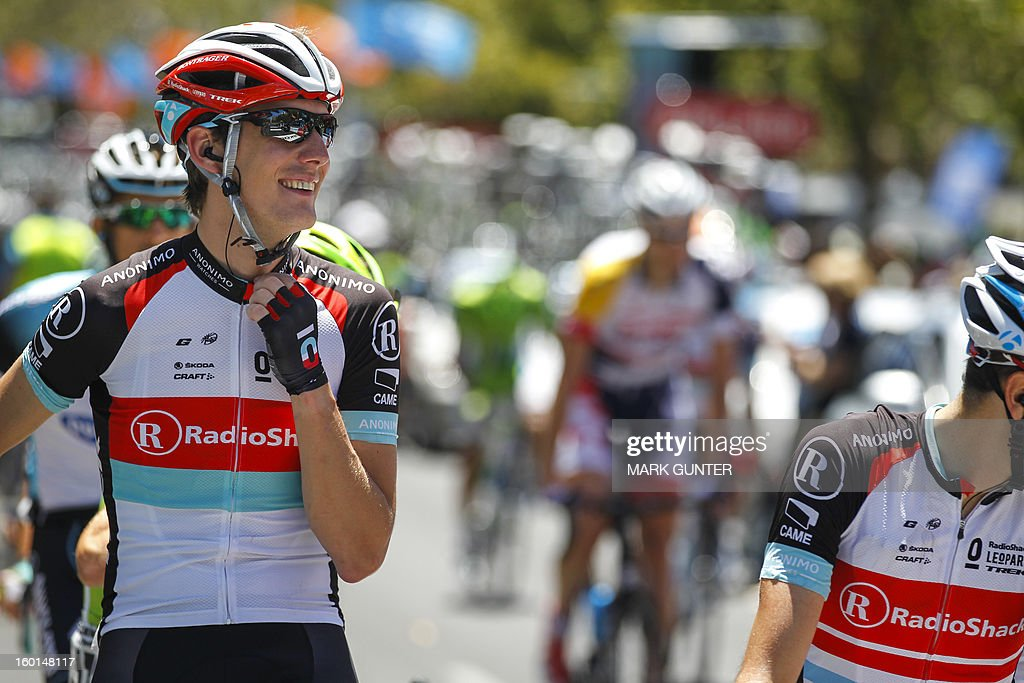 Andy Schleck of Luxembourg smiles prior to the start of the 90-km stage 6 around the streets of Adelaide on the final day of the Tour Down Under cycling race on January 27, 2013. AFP PHOTO / Mark Gunter USE