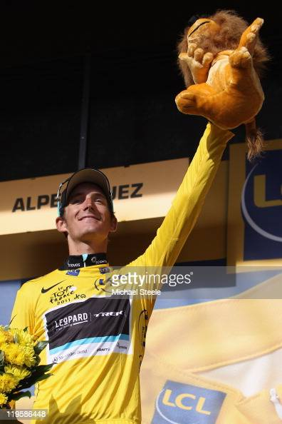 Andy Schleck of Luxemburg and Team LeopardTrek celebrates capturing the leaders yellow jersey after Stage 19 of the 2011 Tour de France from Modane...