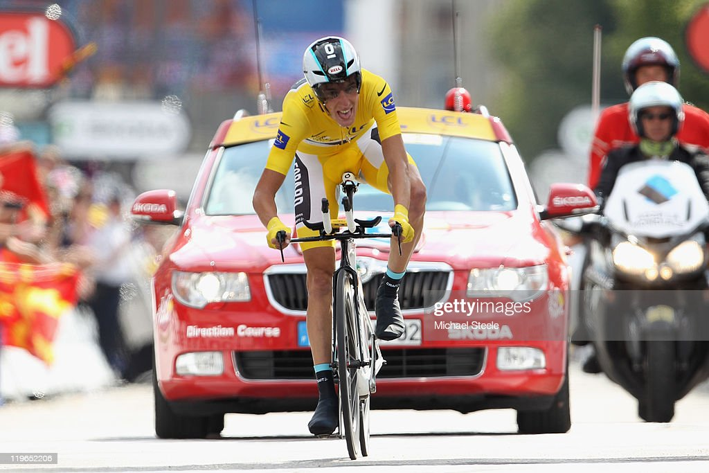 Andy Schleck of Luxemburg and Team Leopard-Trek grimaces as he crosses the finish line to lose the leaders yellow jersey with one stage remaining during the Individual Time Trial Stage 20 of the 2011 Tour de France on July 23, 2011 in Grenoble, France.