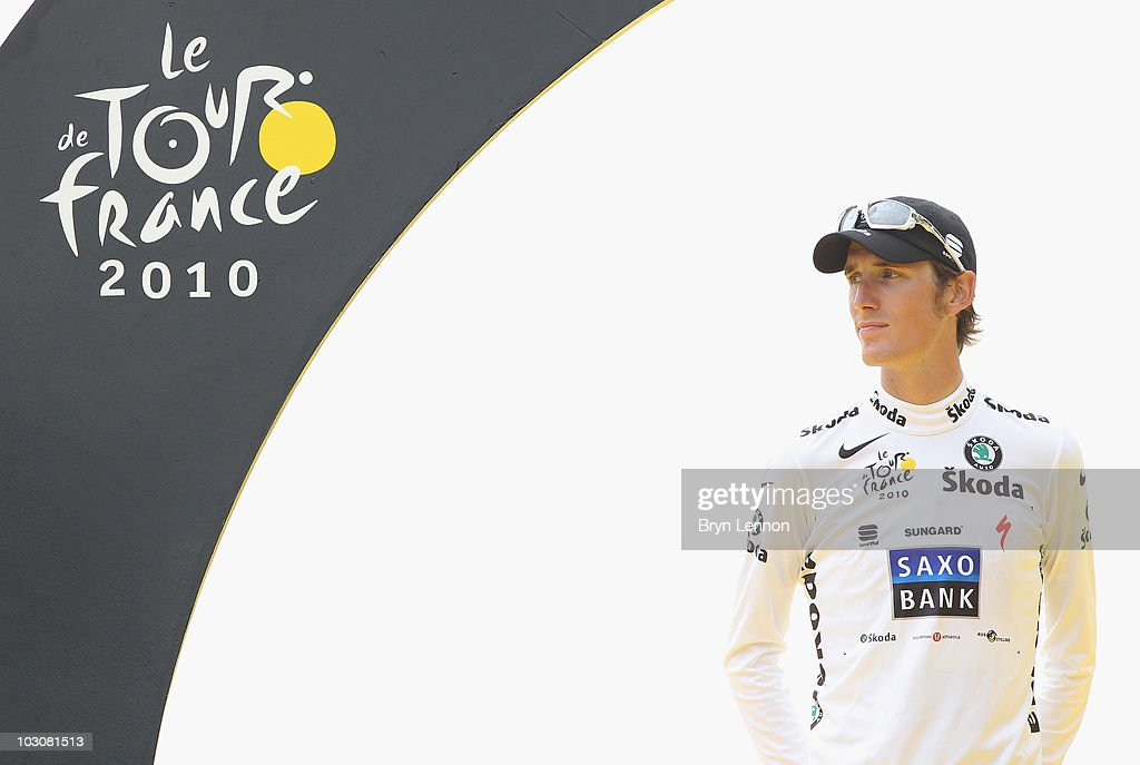<a gi-track='captionPersonalityLinkClicked' href=/galleries/search?phrase=Andy+Schleck&family=editorial&specificpeople=768445 ng-click='$event.stopPropagation()'>Andy Schleck</a> (L) of team Saxo Bank looks on as he stands on the podium wearing the young riders jersey after the twentieth and final stage of Le Tour de France 2010, from Longjumeau to the Champs-Elysees in Paris on July 25, 2010 in Paris, France.