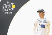Andy Schleck of team Saxo Bank looks on as he stands on the podium wearing the young riders jersey after the twentieth and final stage of Le Tour de...